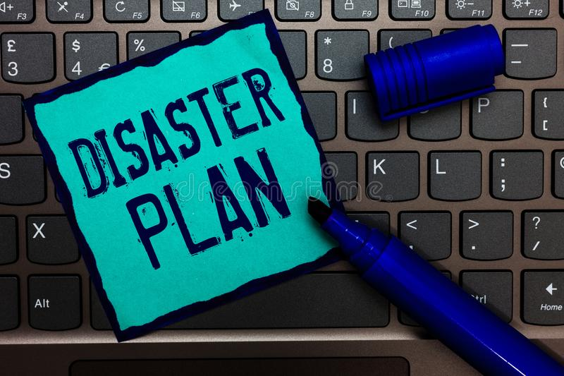 Word writing text Disaster Plan. Business concept for Respond to Emergency Preparedness Survival and First Aid Kit Turquoise paper. Keyboard Inspiration stock image