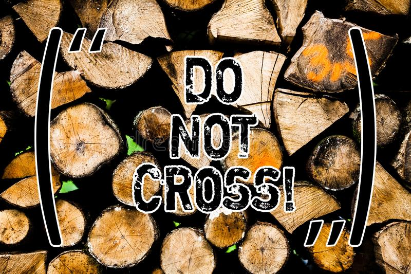 Word writing text Do Not Cross. Business concept for Crossing is forbidden dangerous caution warning not to do it Wooden. Background vintage wood wild message royalty free stock image