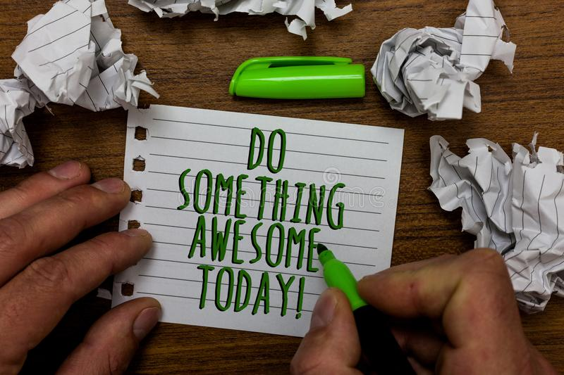 Word writing text Do Something Awesome Today. Business concept for Make an incredible action motivate yourself Hand hold green pen royalty free stock photo