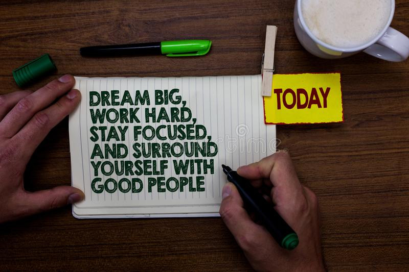 Word writing text Dream Big, Work Hard, Stay Focused, And Surround Yourself With Good People. Business concept for 0 Man holding m. Arker notebook clothespin royalty free stock photo