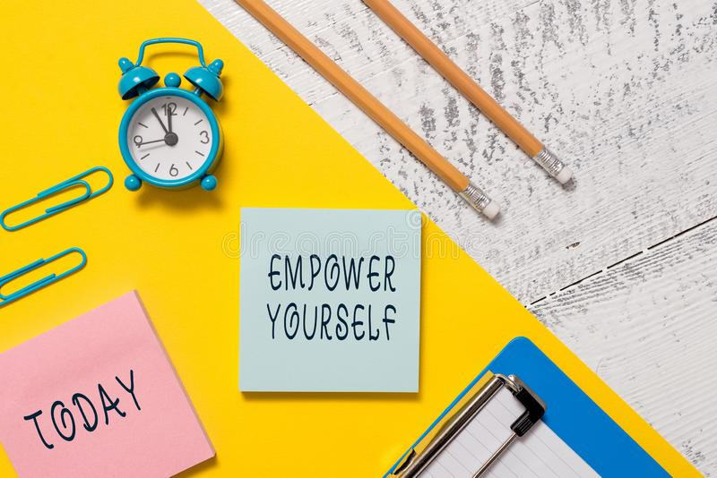 Word writing text Empower Yourself. Business concept for taking control of life setting goals positive choices Notepads. Word writing text Empower Yourself stock photography