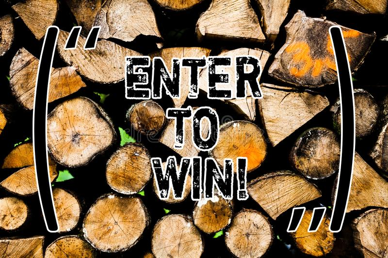 Word writing text Enter To Win. Business concept for Sweepstakes Trying the luck to earn the big prize Lottery Wooden background. Vintage wood wild message stock photography