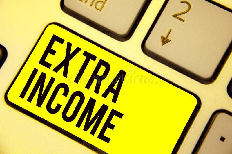 Word writing text Extra Income. Business concept for Additional fund received or earned from a non regular basis Keyboard yellow k. Ey Intention create computer stock photo
