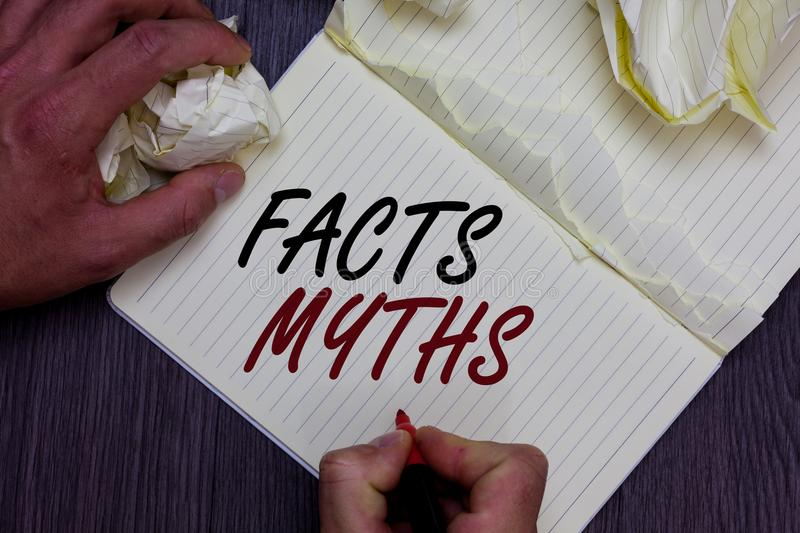 Word writing text Facts Myths. Business concept for work based on imagination rather than on real life difference Man holding mark royalty free stock photography