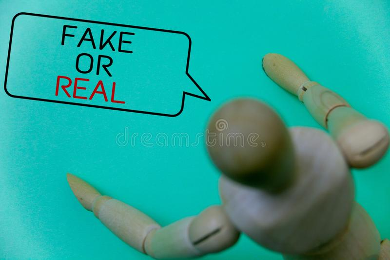 Word writing text Fake Or Real. Business concept for checking if products are original or not checking quality Cyan background rob. Ot imaginations idea message stock photos