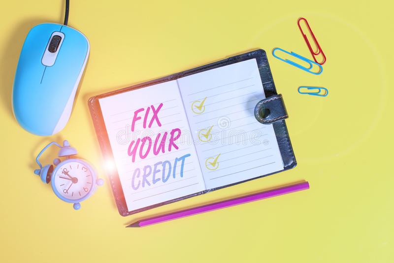 Word writing text Fix Your Credit. Business concept for Keep balances low on credit cards and other credit Locked diary. Word writing text Fix Your Credit royalty free stock photos