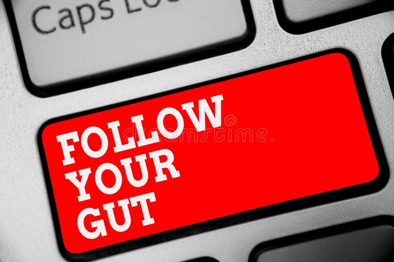 Word writing text Follow Your Gut. Business concept for Listen to intuition feelings emotions conscious perception Keyboard red ke. Y Intention create computer royalty free stock images