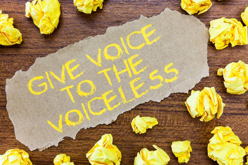 Word writing text Give Voice To The Voiceless. Business concept for Speak out on Behalf Defend the Vulnerable.  royalty free stock photo