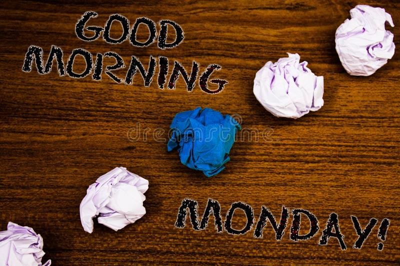 Word writing text Good Morning Monday Motivational Call. Business concept for Happy Positivity Energetic Breakfast Brown woody des. Ktop four white crumpled stock image