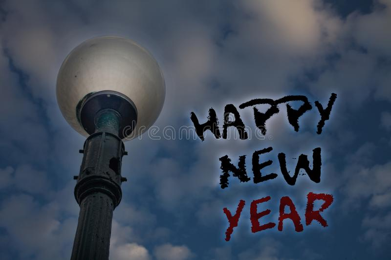 Word writing text Happy New Year. Business concept for congratulations Merry Xmas everyone beginning of January Light post blue cl. Oudy clouds sky ideas message royalty free stock photo