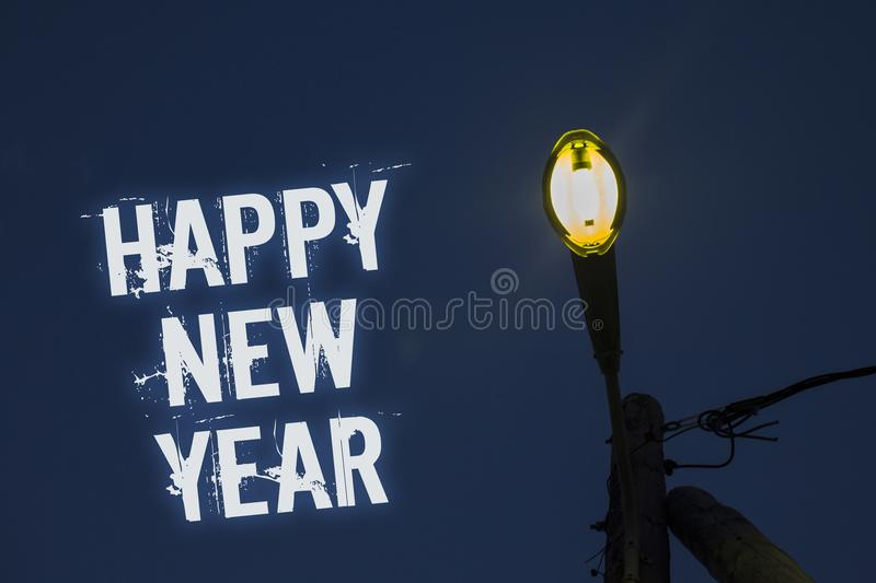 Word writing text Happy New Year. Business concept for congratulations Merry Xmas everyone beginning of January Light post dark bl. Ue cloudy clouds sky ideas stock images