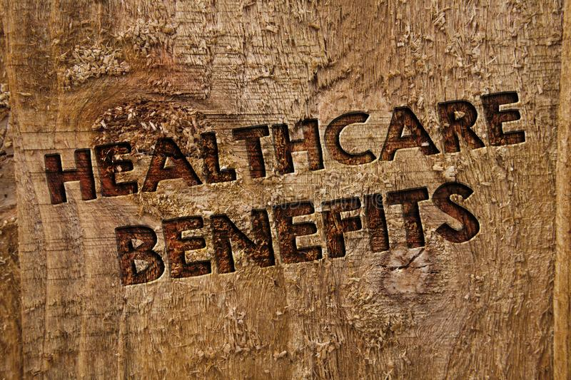Word writing text Healthcare Benefits. Business concept for it is insurance that covers the medical expenses Message banner wood i. Nformation board post plywood stock photos