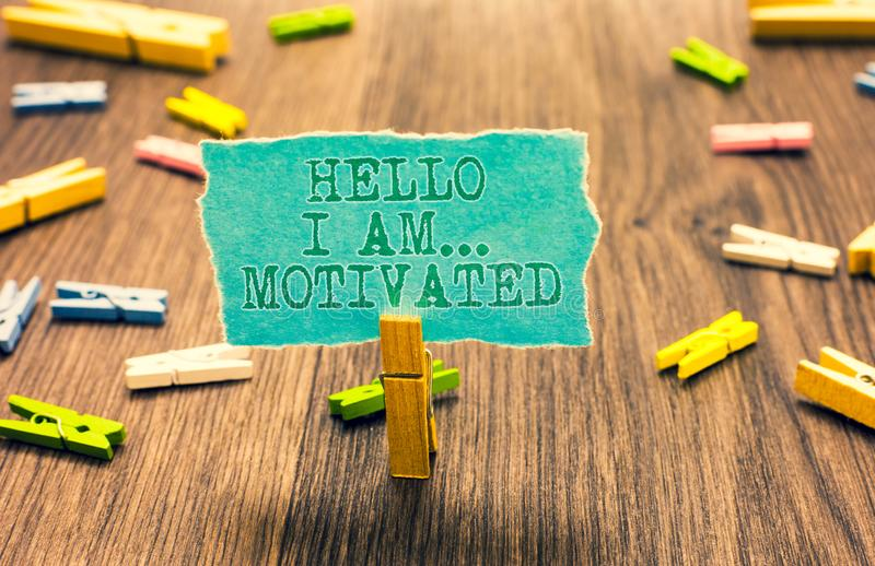 Word writing text Hello I Am... Motivated. Business concept for haivng inner sound to do more in work or life Clothespin holding t. Urquoise paper note several vector illustration