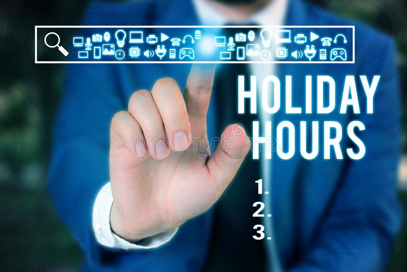 Word writing text Holiday Hours. Business concept for employee receives twice their normal pay for all hours Male human. Word writing text Holiday Hours stock image