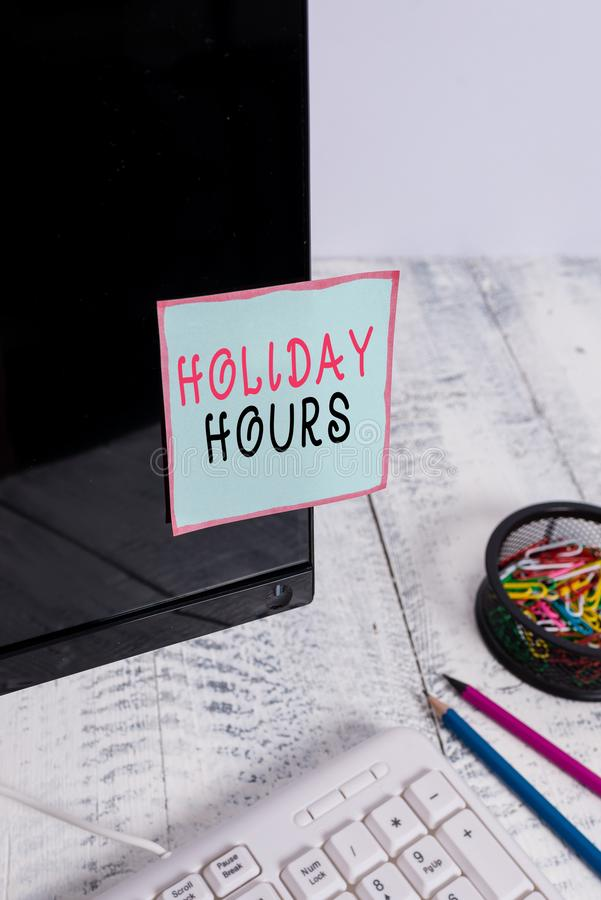 Word writing text Holiday Hours. Business concept for employee receives twice their normal pay for all hours Note paper. Word writing text Holiday Hours stock image