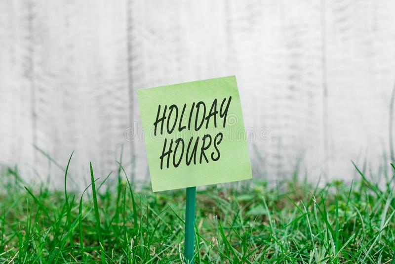 Word writing text Holiday Hours. Business concept for employee receives twice their normal pay for all hours Plain empty. Word writing text Holiday Hours stock photography