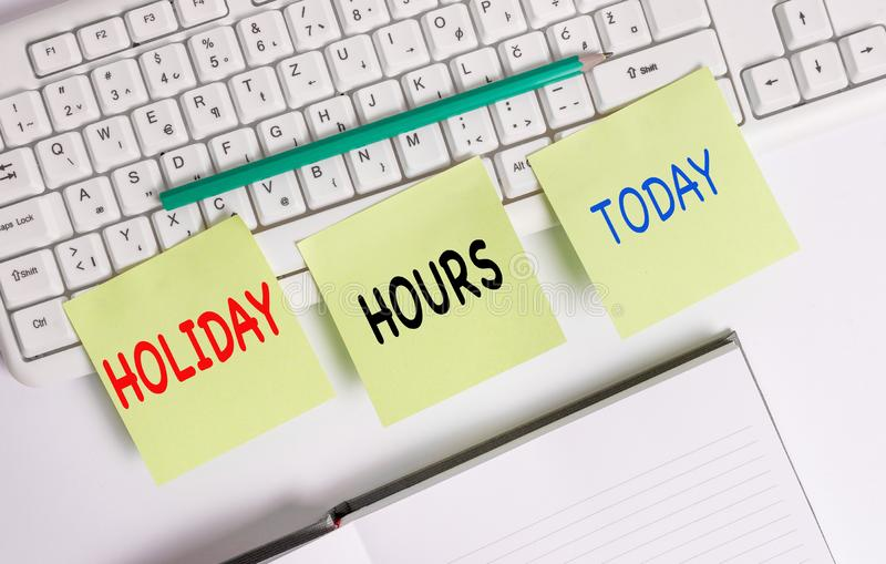 Word writing text Holiday Hours. Business concept for employee receives twice their normal pay for all hours Three empty. Word writing text Holiday Hours stock images