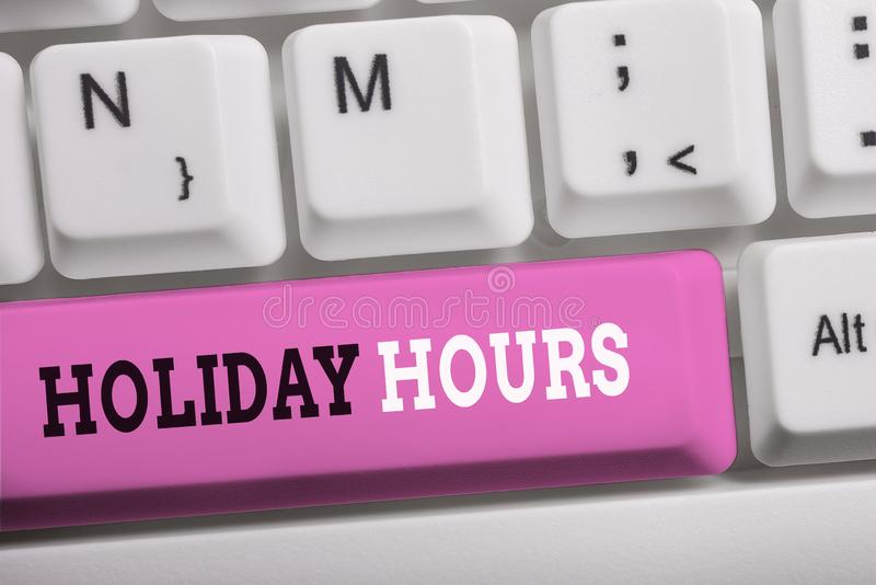 Word writing text Holiday Hours. Business concept for employee receives twice their normal pay for all hours White pc. Word writing text Holiday Hours. Business royalty free stock photography