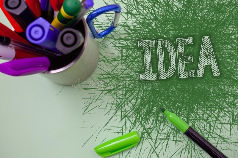 Word writing text Idea. Business concept for Creative Innovative Thinking Imagination Design Planning Solutions Scratched table cu royalty free stock images