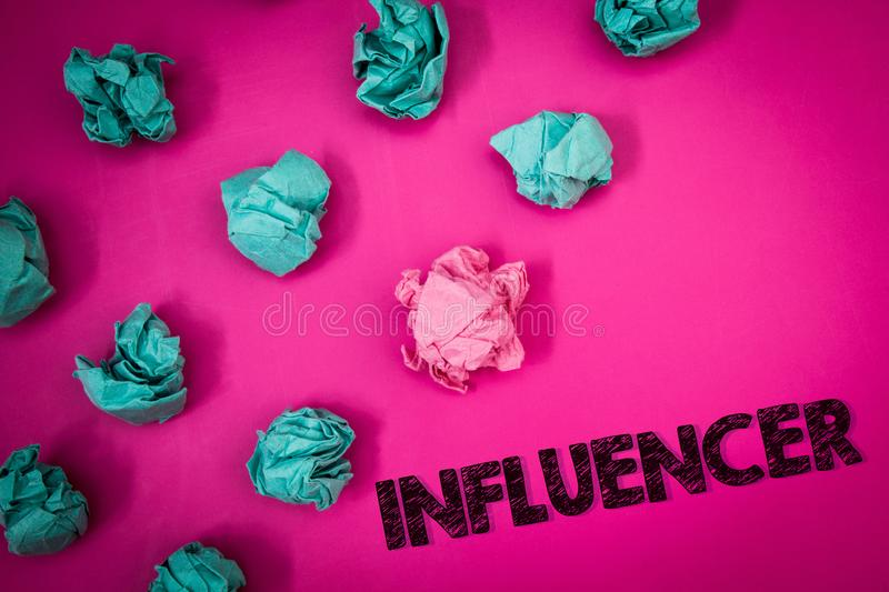 Word writing text Influencer. Business concept for Person who influences and affect decisions opinions of others Ideas messages th. Oughts pink background royalty free stock photo