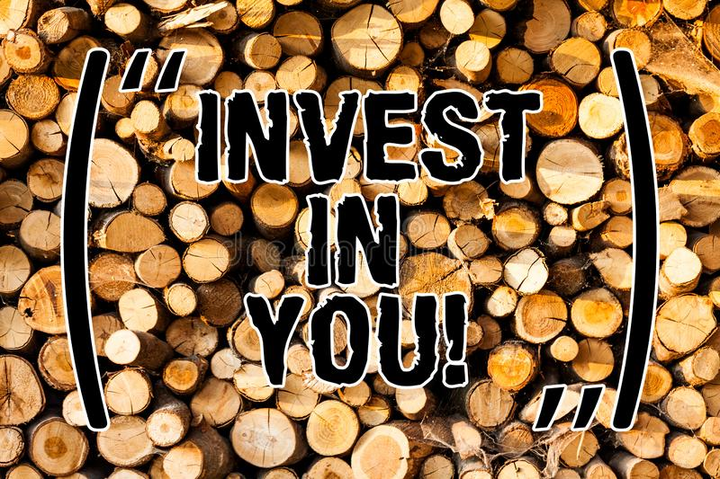 Word writing text Invest In You. Business concept for Take care of yourself buy things for you Motivation Inspire Wooden. Background vintage wood wild message stock images