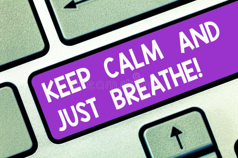 Word writing text Keep Calm And Just Breathe. Business concept for Take a break to overcome everyday difficulties. Keyboard key Intention to create computer royalty free stock photo