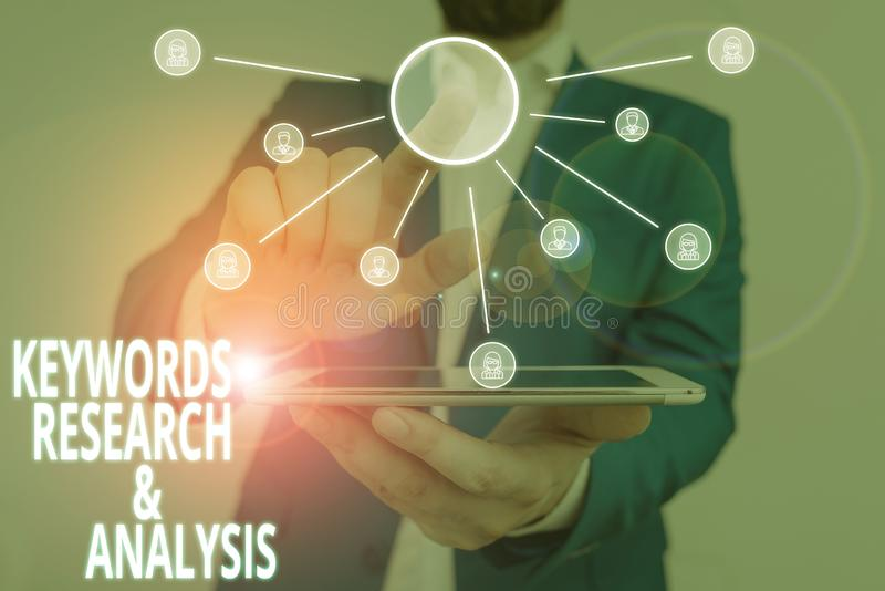 Word writing text Keywords Research And Analysis. Business concept for search for data and create tables graphs Male. Word writing text Keywords Research And royalty free stock images