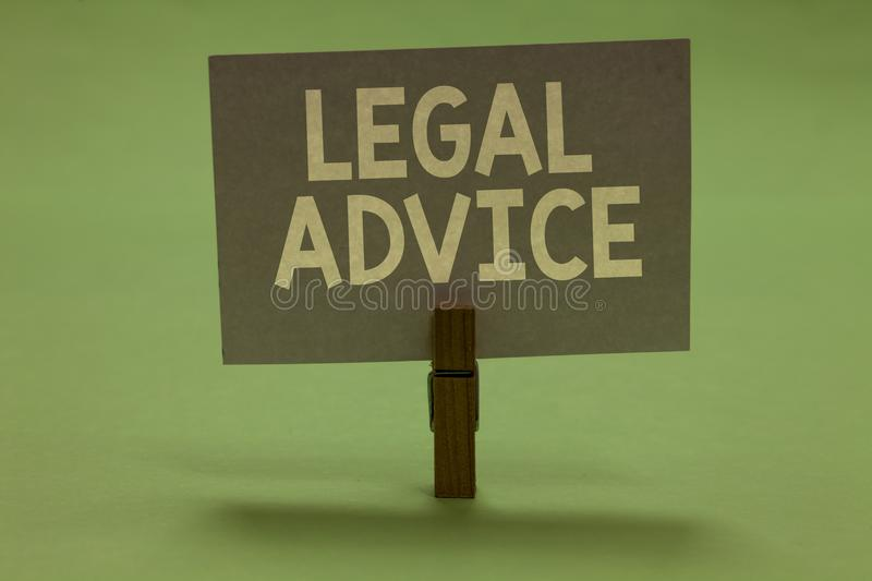 Word writing text Legal Advice. Business concept for Lawyer opinion about law procedure in a particular situation Clothespin holdi. Ng gray paper important stock photo