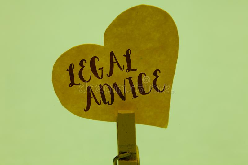 Word writing text Legal Advice. Business concept for Lawyer opinion about law procedure in a particular situation Clothespin holdi. Ng yellow paper heart stock images