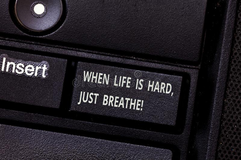 Word writing text When Life Is Hard Just Breathe. Business concept for Take a break to overcome difficulties Keyboard. Key Intention to create computer message royalty free stock images