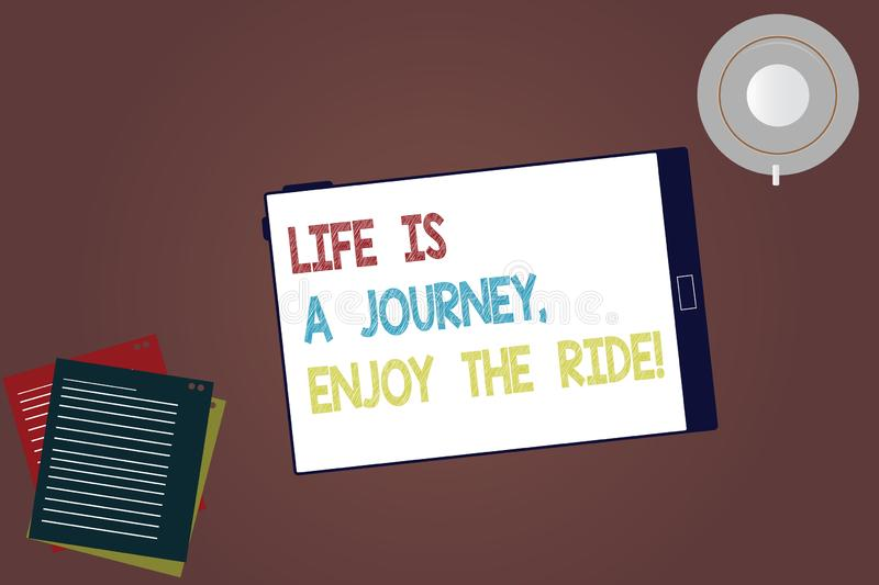 Word writing text Life Is A Journey Enjoy The Ride. Business concept for Enjoying things that happen everyday Tablet Empty Screen. Cup Saucer and Filler Sheets stock photo