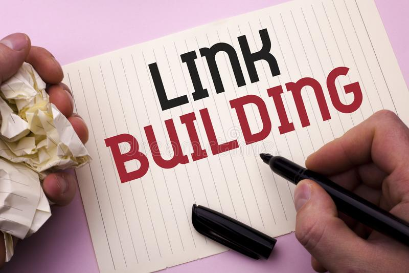 Word writing text Link Building. Business concept for Process of acquiring hyperlinks from other websites Connection written by Ma. N Notebook Paper Holding royalty free stock image