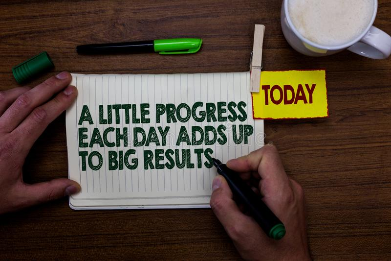 Word writing text A Little Progress Each Day Adds Up To Big Results. Business concept for Step by step reach goal Man holding mark. Er notebook clothespin royalty free stock photos