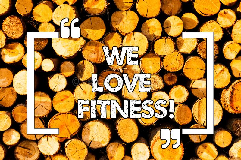 Word writing text We Love Fitness. Business concept for Having affection for sport exercises good healthy diet Wooden. Background vintage wood wild message royalty free stock image