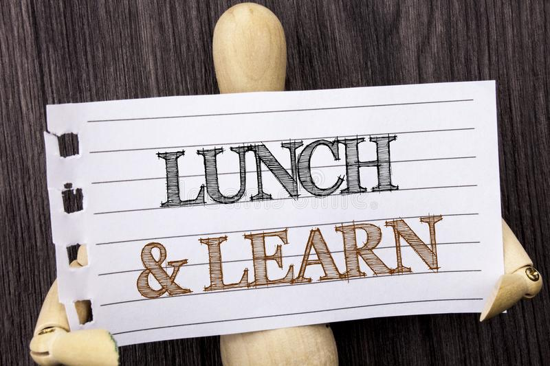 Word, writing, text Lunch And Learn. Conceptual photo Presentation Training Board Course written on torn paper holding by sculptu. Word, writing, text Lunch And royalty free stock photos