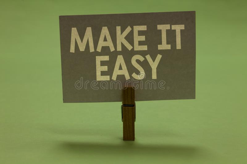Word writing text Make It Easy. Business concept for Smart approach Effortless Free from worries or difficulties Clothespin holdin. G gray paper important stock photo