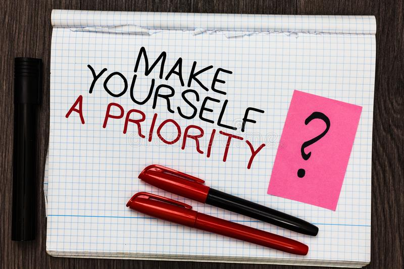 Word writing text Make Yourself A Priority. Business concept for Think in your own good first personal development Color pen on wr. Itten notepad with question royalty free stock images