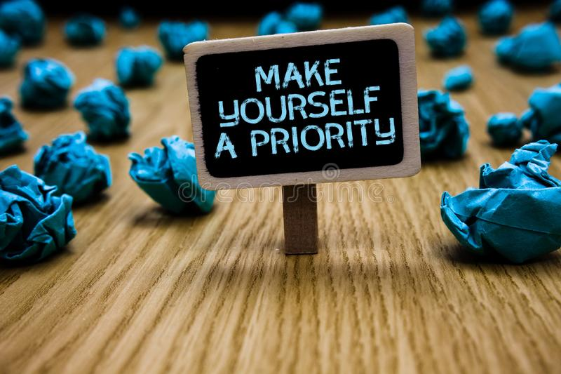 Word writing text Make Yourself A Priority. Business concept for Think in your own good first personal development Paperclip hold. Black paperboard with text stock images