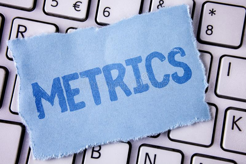 Word writing text Metrics. Business concept for Method of measuring something Study poetic meters Set of numbers written on Tear S. Word writing text Metrics royalty free stock photos