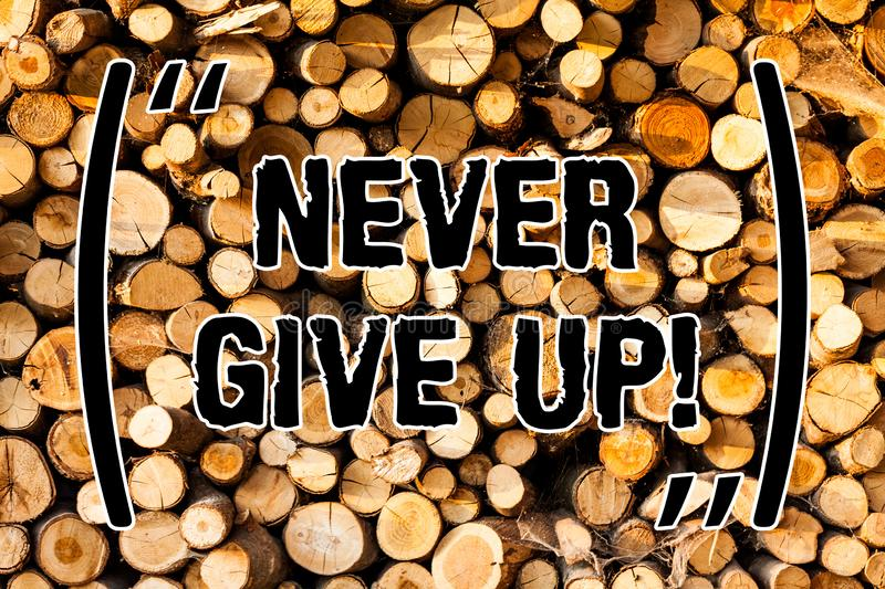 Word writing text Never Give Up. Business concept for Keep trying until you succeed follow your dreams goals Wooden. Background vintage wood wild message ideas stock photos