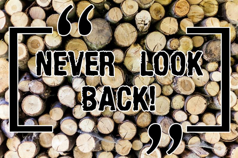 Word writing text Never Look Back. Business concept for Do not have regrets for your actions be optimistic Wooden. Background vintage wood wild message ideas stock photo