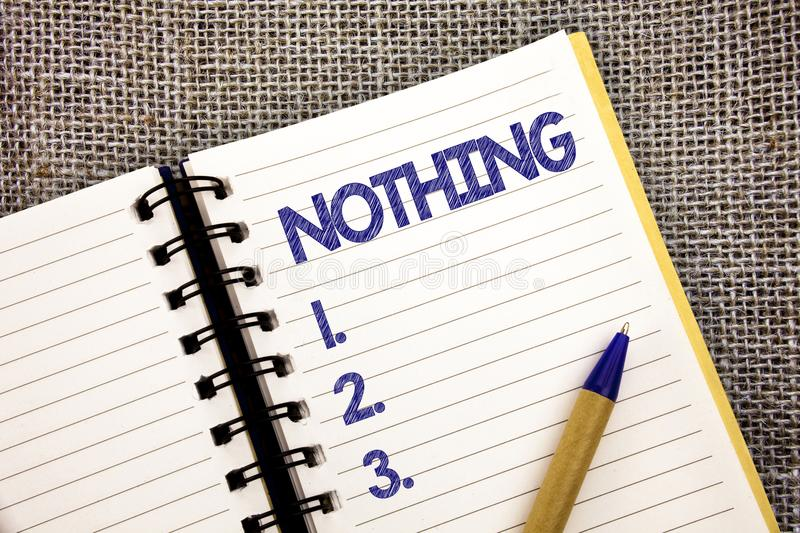 Word writing text Nothing. Business concept for Not anything No single thing or value Absence of progress Blank Ball point pen wor. K spring diary chronicle stock image