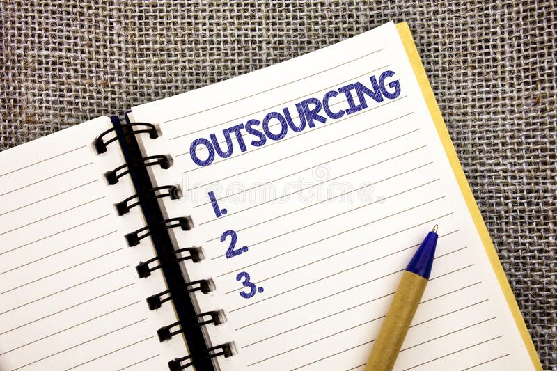 Word writing text Outsourcing. Business concept for Obtain goods or service by contract from an outside supplier Ball point pen wo. Rk spring diary chronicle stock photography