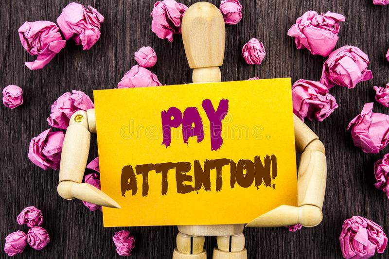 Word, writing, text Pay Attention. Conceptual photo Be Careful Beware Mindful Alarm written on Sticky Note Holding By Sculpture o. Word, writing, text Pay royalty free stock images