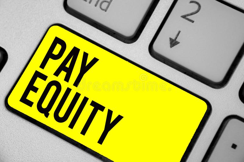 Word writing text Pay Equity. Business concept for eliminating sex and race discrimination in wage systems Keyboard yellow key Int. Ention create computer royalty free stock images