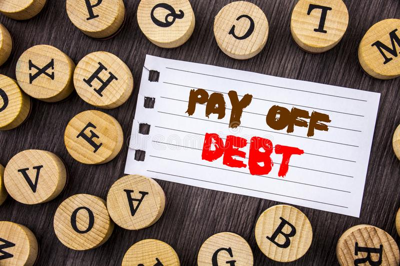 Word, writing, text Pay Off Debt. Conceptual photo Reminder To Paying Owed Financial Credit Loan Bills written on tear notobook p. Aper on wooden background with stock photos