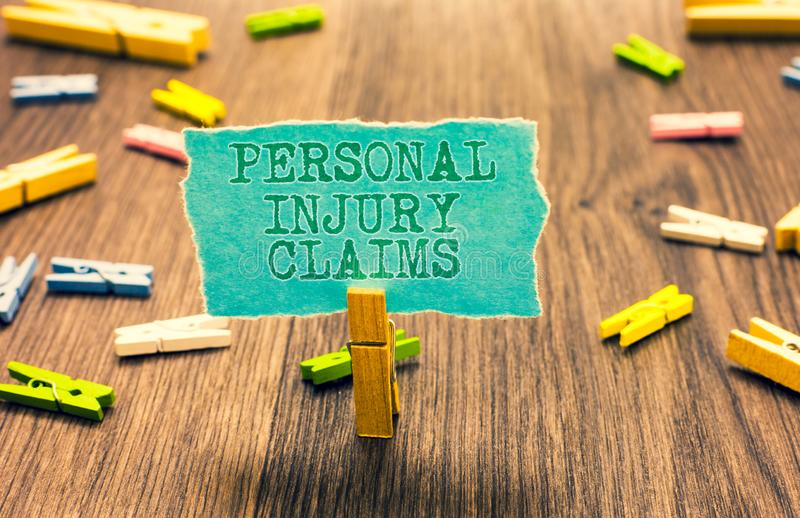 Word writing text Personal Injury Claims. Business concept for being hurt or injured inside work environment Clothespin. Holding turquoise paper note several stock photos