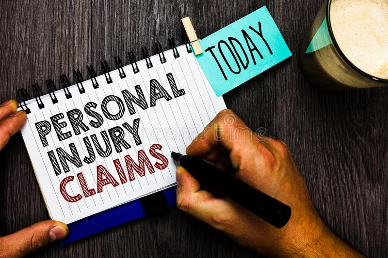Word writing text Personal Injury Claims. Business concept for being hurt or injured inside work environment Man holding marker no. Tebook clothespin hold stock images