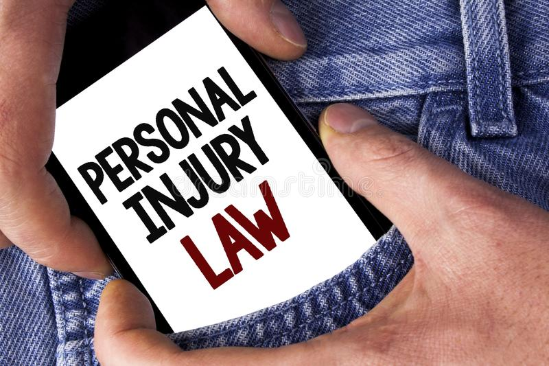 Word writing text Personal Injury Law. Business concept for guarantee your rights in case of hazards or risks written on Mobile ph. Word writing text Personal royalty free stock photos