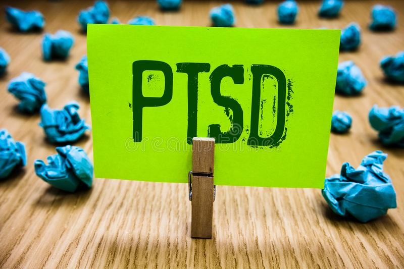 Word writing text Ptsd. Business concept for Post Traumatic Stress Disorder Mental Illness Trauma Fear Depression Paper cyan objec. T thoughts crumpled papers stock photo